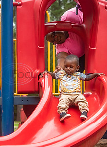 Lexi Sherman of Tyler helps her son Elijah Simmons, 1, on the slide at the playground outside of the Glass Recreation Center on July 4, 2019.  (Sarah A. Miller/Tyler Morning Telegraph)