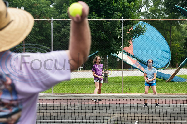 Ray Reilly of Tyler tosses a tennis ball to his daughters Cassie Reilly, 11, and Courtney Reilly, 10, at Fun Forest Park in Tyler on July 4, 2019.  (Sarah A. Miller/Tyler Morning Telegraph)