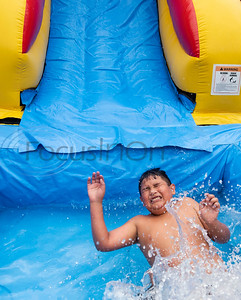 Reynaldo Marquez, 9, splashes down into water from an inflatable bounce house pool slide at his home in Tyler on July 4, 2019.  (Sarah A. Miller/Tyler Morning Telegraph)