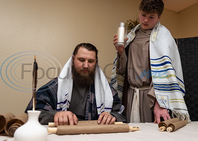 Christian Arndt, portraying a head Rabi, (left) looks over scrolls as Ethan Bennett, as a scribe, looks on in a scene during rehearsal for a live Nativity reenactment at West Lake Baptist Church Wednesday, Dec. 11, 2019, in Chandler. (Cara Campbell/Tyler Morning Telegraph)