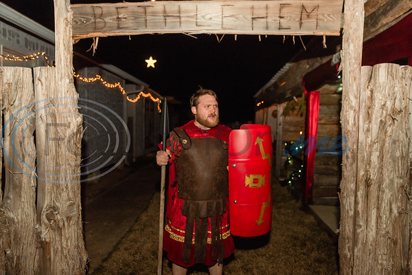 """Tristan Bussell, portraying a Roman guard, stands at the entrance of """"Bethlehem"""" during rehearsal for a live Nativity reenactment at West Lake Baptist Church Wednesday, Dec. 11, 2019, in Chandler. (Cara Campbell/Tyler Morning Telegraph)"""