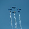 The Red bulls aerobatic team going vertical.