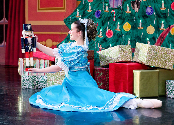 Mark Maynard | for The Herald Bulletin<br /> Claire (Natahalie Boyle) is thrilled and intrigued by the nutcracker given to her as a Christmas gift by Mr. Drosselmeyer.