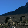 Morning at Karanga camp on the fourth day. Toilet on the right, and a Kilimanjaro Raven sitting on the rock in the centre of the photo.