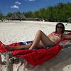 Catherine relaxing in the sun on Kwenda beach, north Zanzibar.