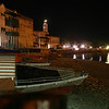 Old stone town waterfront at night.