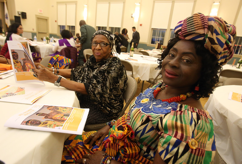 African Community Center of Lowell's 2nd anniversary dinner and fundraiser. Margaret Brobbey, left, and Comfort Agyei, both of Lowell.  (SUN/Julia Malakie)