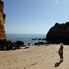 Sandstone rocks on beach near Lagos harbour - Pauline admiring!