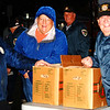 Debbie Blank | The Herald-Tribune<br /> Prell-Bland American Legion Post 271 members (from left) Mike Gutzwiller and Richard Narwold, Batesville, and Johnny Baumer, Oldenburg, prepare to pass out goody bags in front of the Memorial Building at the end of the 2018 Batesville Halloween Parade.