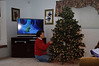 Grandma's trying to look like the sloth on TV while decorating the tree!