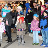 Debbie Blank | The Herald-Tribune<br /> When Santa began leading a Christmas carol from the stage with the help of Mayor Mike Bettice, area families were in awe.