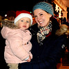 Debbie Blank | The Herald-Tribune<br /> The Batesville Community Tree Lighting dazzled many families, including Kathy Beckner, Batesville, and daughter Zoey, 2. The Dec. 1 event was sponsored by the city of Batesville, Batesville Main Street, Batesville Area Chamber of Commerce, Batesville Beautification League and Mayor's Youth Council.