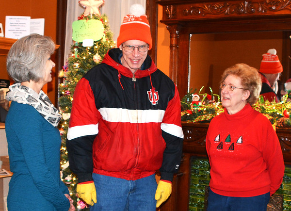 "Debbie Blank | The Herald-Tribune<br /> Doug Browne (center) planned to check out the holiday cookie sale and Batesville Area Historical Society exhibit ""Magical Christmas – Elves and Fairies""  after chatting with members Christy Moenter (left) and Arlene Wachsmann at the Batesville Historical Center."