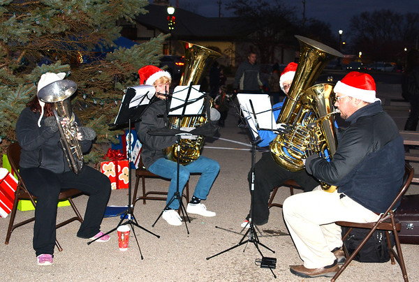 Debbie Blank | The Herald-Tribune<br /> The sounds of the Batesville High School tuba quartet welcomed spectators downtown.