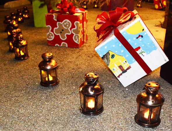 Debbie Blank   The Herald-Tribune<br /> After the Batesville Intermediate School Chorale took part in the children's lantern parade, depicting early Indiana settlers, the students set the lanterns in a circle surrounding the tree. Downtown decorated boxes were created by Batesville High School art students.