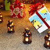 Debbie Blank | The Herald-Tribune<br /> After the Batesville Intermediate School Chorale took part in the children's lantern parade, depicting early Indiana settlers, the students set the lanterns in a circle surrounding the tree. Downtown decorated boxes were created by Batesville High School art students.
