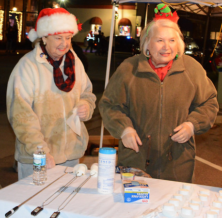 Debbie Blank | The Herald-Tribune Batesville Beautification League members Jinny Stewart (left) and Ruth Monaco supply families with marshmallows on sticks to be roasted at the fire pit.