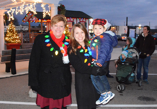 Debbie Blank | The Herald-Tribune Wife Lorie Bettice (from left), daughter Holly Enneking and grandson James, 3, Plainfield, arrive to watch Mayor Mike Bettice emcee the Batesville Community Tree Lighting.