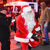 Debbie Blank | The Herald-Tribune<br /> Santa hopped off of a Batesville firetruck on Main Street to greet the throngs of people waiting to see him.
