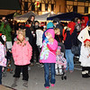 Debbie Blank | The Herald-Tribune<br /> Hundreds of area residents mingled downtown not only to see the tree and Santa, but also to sing, eat and shop at outdoor vendors.
