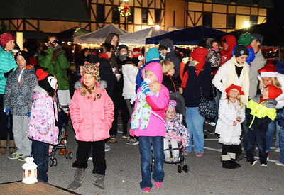Debbie Blank | The Herald-Tribune Hundreds of area residents mingled downtown not only to see the tree and Santa, but also to sing, eat and shop at outdoor vendors.