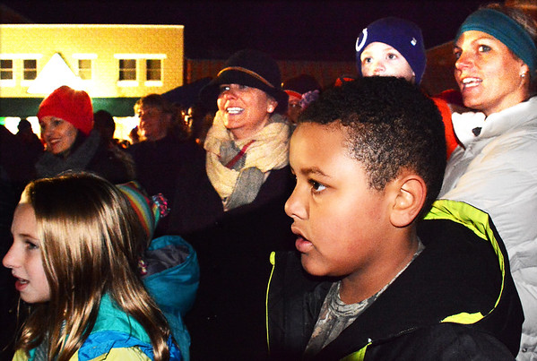 "Debbie Blank | The Herald-Tribune Jolly old St. Nick captivated the crowd, then visited with children in his workshop. Sean Townsley, Batesville Main Street Promotional Committee chair, says the goal of the seventh annual event was to ""promote our special brand of small town cheer and community goodwill."""