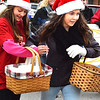Debbie Blank | The Herald-Tribune<br /> Schmidt Bakery helpers distribute cookies to lucky spectators.