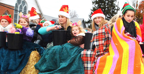 Debbie Blank   The Herald-Tribune<br /> On a frosty afternoon, blankets are key to staying warm on a float.
