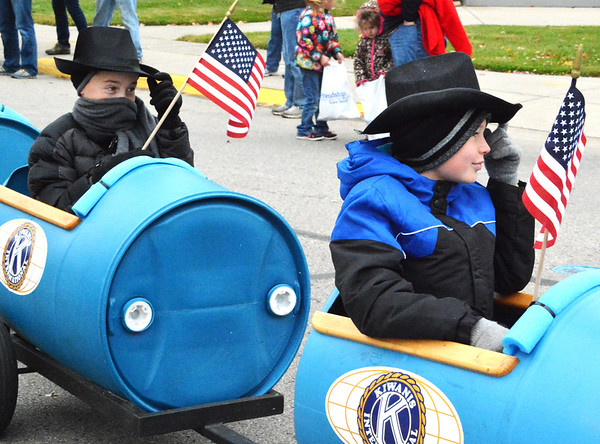 Debbie Blank | The Herald-Tribune<br /> Boys riding in the Kiwanis Club of Batesville train were patriotic and bundled up.