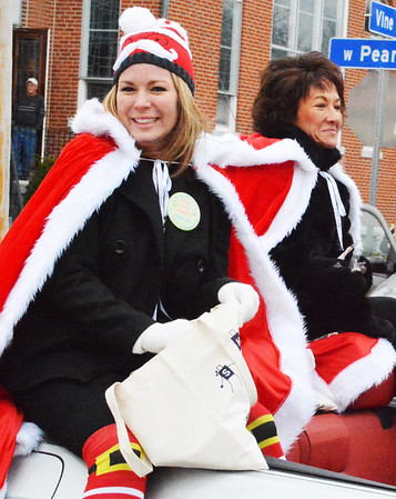 Debbie Blank | The Herald-Tribune<br /> Executive director Anna Ibold (left) of the parade sponsoring Batesville Area Chamber of Commerce rides in a convertible with office coordinator Patricia Hatcher.