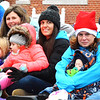 Debbie Blank | The Herald-Tribune<br /> Mom2Mom members and their kids rode on a float as Grand Marshals to represent the 2016 Batesville Area Chamber of Commerce Distinguished Organization.