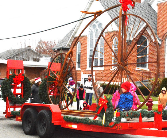 Debbie Blank   The Herald-Tribune<br /> Winning second place in the float contest was a giant vintage bicycle fabricated by Red Forge, Morris.