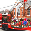 Debbie Blank | The Herald-Tribune<br /> Winning second place in the float contest was a giant vintage bicycle fabricated by Red Forge, Morris.