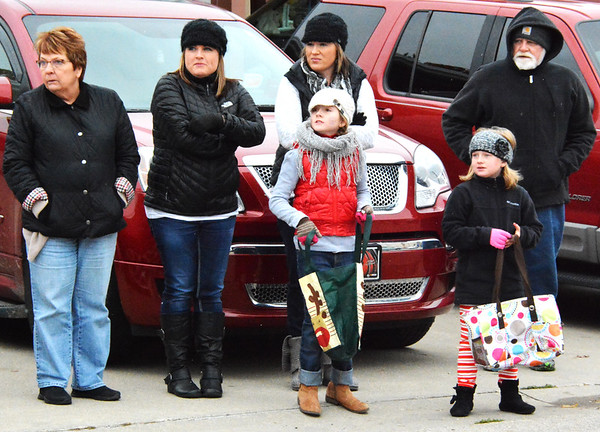 Debbie Blank | The Herald-Tribune<br /> Jackie Bedel (second from left), Metamora, and her daughters Kaylynn, 9, and Jayla, 7, enjoy watching the parade with her parents Sarah (left) and John White, Bloomingrton, and her sister, Renee Bedel, Batesville.