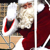 Debbie Blank | The Herald-Tribune<br /> After his sleigh was pulled by a horse in the procession, Santa listened to children's wishes at RomWeber Marketplace.