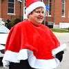 Debbie Blank | The Herald-Tribune<br /> Batesville Area Chamber of Commerce Distinguished Service Award winner and parade Grand Marshal Sue Siefert handed out messages that inspired parade-goers to help those less fortunate.