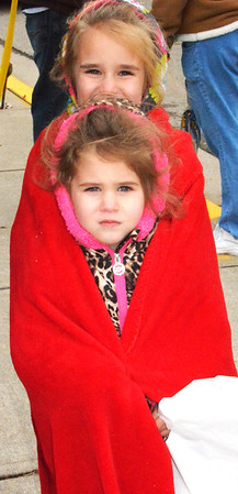 Debbie Blank | The Herald-Tribune<br /> Cincinnati residents and sisters Kylie (front), 3, and Arabelle, 6, bundled up together before the procession. They were here for the weekend to visit a great-uncle and -aunt, Rick and Rita Lewis, Batesville.