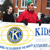 Debbie Blank | The Herald-Tribune<br /> Kiwanis Club of Batesville members (from left) Rita Seig, Ed Krause and Bob Fitzpatrick carry the banner to remind the crowd of their organization's mission.