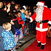 Debbie Blank | The Herald-Tribune<br /> Cellphones were whipped out for photos as Santa shook hands on the red carpet.