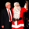"Debbie Blank | The Herald-Tribune<br /> Santa jingled his bells when he told spectators they should be thankful ""to have this wonderful town."" With him is the mayor."
