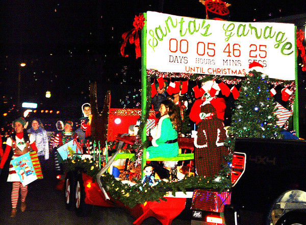Debbie Blank | The Herald-Tribune<br /> Many people were involved with the spectacular Santa's Garage float by Enneking Auto Body and True Blue Autos, which captured second place. First place went to the Flannery family float.