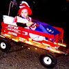 Diane Raver | The Herald-Tribune<br /> This young lady had the perfect way to travel along the parade route.