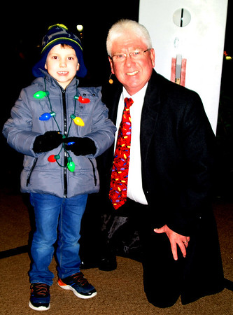 Debbie Blank | The Herald-Tribune<br /> Mayor Mike Bettice's oldest grandchild, James Enneking, 5, Plainfield, threw the switch to light the tree.