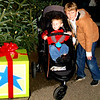 Debbie Blank | The Herald-Tribune<br /> Brothers Eli, 2, and Levi Freese, 8, Batesville, get caught up in the excitement of the procession and tree lighting.