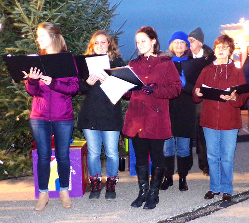 Diane Raver | The Herald-Tribune<br /> Boar's Head Festival choir members sang songs in front of the Christmas tree.