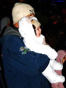 Debbie Blank | The Herald-Tribune A bundled up baby awaits the ceremony.