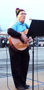 Diane Raver   The Herald-Tribune Mike Fritsch entertained the crowd by singing Christmas carols.