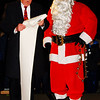Debbie Blank | The Herald-Tribune<br /> Just before the tree lighting, Mayor Mike Bettice reads a proclamation about Christmas in Batesville under the watchful eyes of Santa Claus.