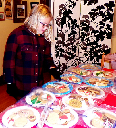 Diane Raver | The Herald-Tribune<br /> Addison McGuire tries to decide which cookies to purchase at the Batesville Historical Center Friday, Nov. 30, on the night of 'Twas the Night Before Christmas Parade and Tree Lighting.