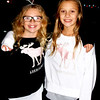 Debbie Blank | The Herald-Tribune<br /> Batesville Intermediate School fifth-graders and friends Katie Lipps (left) and Addison Luers, both 10, wore matching halos to get into the evening's spirit.